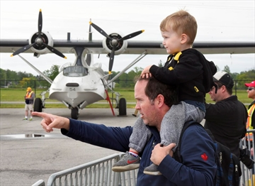Jamie Sullivan points to the Lancaster for his son Cohen, 3, with the PBY Canso in the background. Sullivan's grandfather John Gimour flew Lancaster bombers during the Second World War, simmilar to the Lancaster the museum regularily flies over their home, so they decided to come see the planes on Sunday.