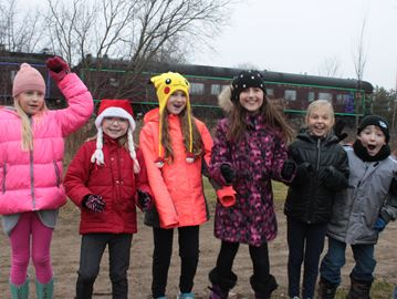Tottenham students watch CP Holiday Train roll through town
