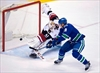 Miller perfect as Canucks blank Coyotes 2-0-Image1