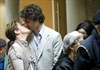 Justin Trudeau, Liberal candidate for the riding of Papineau kisses his wife Sophie Gregoire as he waits in line to cast his vote in Canada's federal election in Montreal on Monday.