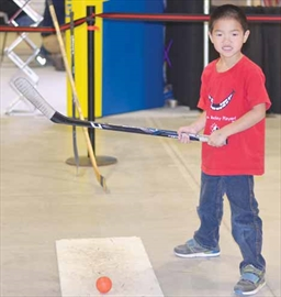 Kyle Van Kralingen, 6, takes a break from shooting pucks at one of the Ottawa Senators activity stations at Hockeyfest on Nov. 24 at the Ernst and Young Centre. The two-day event was held for the first time this year and featured games, vendors and speakers.