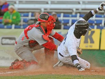 Majors DH Parris Austin slides in under Cardinals catcher Zack Sardellitti to score London's second run in the third inning.