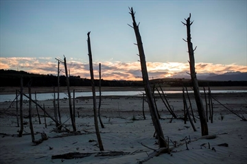 FILE -- In this Feb. 1 2018 file photo, Cape Town's main water supply from the Theewaterskloof dam outside Grabouw, Cape Town. South Africa has declared that the drought afflicting Cape Town and other parts of the country is a national disaster. (AP Photo/Bram Janssen, File)