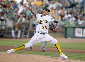 Jays acquire right-hander Chavez from A's-Image1