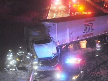 Jack-knife truck on Hwy. 401