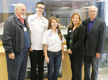 Young Keewatin tour guides receive scholarships