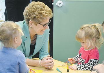 Ontario Premier Kathleen Wynne would have liked to have stayed and played with youngsters Juniper Jackson and Hannah Morningstar, clients at the daycare centre located at the Boys and Girls Clubs of Kawartha Lakes which she toured on Friday (March 28).
