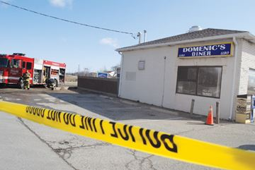 A police line blocks off the scene of the fire at Domenic's Diner Wednesday morning. A blaze caused significant damage to the popular diner at the corner of Highway 20 and Merrittville Highway Tuesday night.