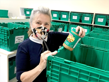 Jen Tenoever, a volunteer with West Lincoln Community Care, sorts food donations into the agency's new food storage totes purchased through an Emergency Community Support Fund from the government of Canada, managed through United Way Niagara.