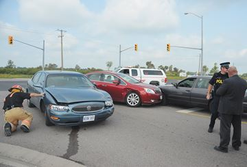 Woman charged in three vehicle collision
