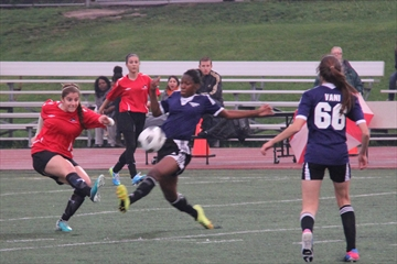 The St. Marcellinus Spirit hosted their fifth annual Friday Night Lights soccer triple header last night. The Spirit's Stephanie Barcelos (left) kicks the ball out of harms way in the senior girls' contest.