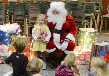 Avery Innes, 3, poses with Santa at the Markville SS children's Christmas party.