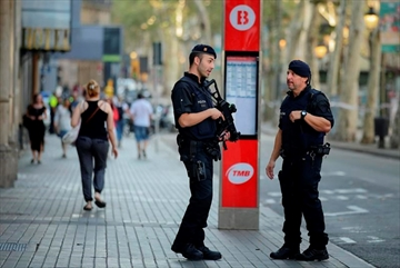 Armed police officers patrol a street in Las Ramblas, Barcelona, Spain, Friday, Aug. 18, 2017. Spanish authorities say Canada is among the countries with citizens killed or injured in the terrorist attack in Barcelona that killed at least 13, as the manhunt intensified for the perpetrators of Europe's latest rampage claimed by the Islamic State group. THE CANADIAN PRESS/AP-Manu Fernandez