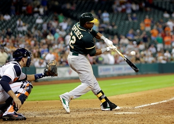 AP source: A's acquire Lester, Gomes for Cespedes-Image1