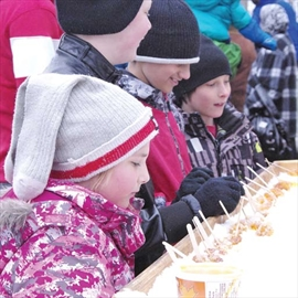 Children wait patiently as volunteers prepare maple taffy outside of the Vanier maple sugar shack at Richelieu Park on April 5. Just one part of the Maple Sugar Festival's activities, grown-ups and children alike had a taste of the sweet stuff.