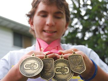 Fort Erie athlete Adam McLeod won four gold medals at the high school track level, and he did it with just three per cent vision.