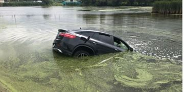 This car went into a Holland Marsh canal after the driver lost control.