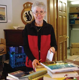 Claire Sullivan sorts piles and piles of books at the Rockcliffe Park Community Hall on Feb. 26 in preparation for the annual book sale on April 12-13. The sale invites book-lovers from across the city to purchase used, new, and rare books and media.