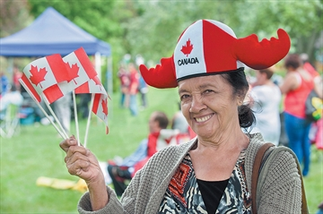 Luz Henriquez dresses for the occasion during 2015 Canada Day celebrations in Thomson Memorial Park. The event returns this year between 10 a.m. and 5 p.m.