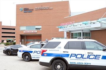 Peel police are investigating after a man with an apparent gunshot wound was found near a Mississauga hospital.