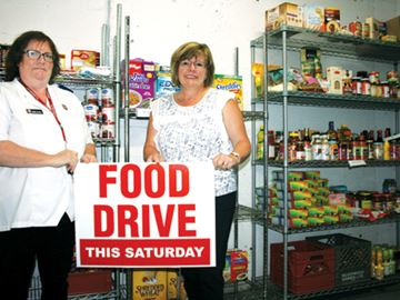 Debby Hackett (left), program manager at the Salvation Army, and Jane Allen, executive director of Dundas Community Services, are getting ready for the Dundas Community Food Drive. The event takes place on Saturday, Sept. 30.