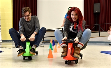 Ben Minor and Siobhan Woodrow of Bell Media Radio demonstrate the use of Plasma cars ahead of a race with the diminutive vehicles as part of the Niagara Children's Centre Help Kids Shine campaign.