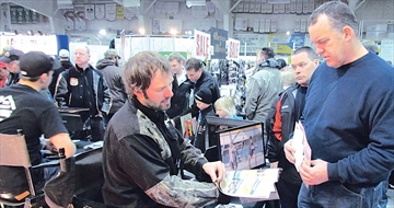 Salesman Greg Amiel of JB's Fishing Depot pulls out a reel for a potential customer. The Toronto business was among dozens of out-of-area businesses across Ontario and beyond at last weekend's annual Valley Fishing &amp
