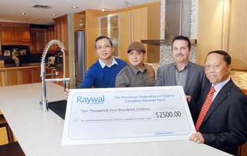 Joel Tantay and John Cruz, employees at Raywal Kitchens, Brian Magee, president of Raywal and Alex Chiu, Ward 8 councillor, gather at the Thornhill business as Raywal makes a donation to Philippine typhoon relief effort through money raised by employees at the business on Green Lane.