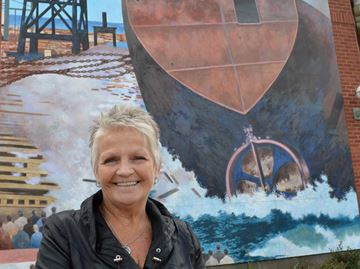 Famous Collingwood mural returns to downtown