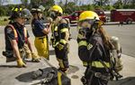 Female Firefighter In Training