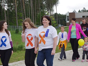 About 250 Nottawasaga Pines Secondary School students and staff walked the Angus school's track for its first Relay For Life, raising $5,000 for the Canadian Cancer Society.