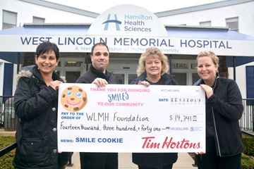 From left, Dara Macleod, administrative officer for West Lincoln Memorial Hospital Foundation, receives the Smile Cookie campaign proceeds of $14,341 from Ryan Ditommaso and Lila MacLeod of Smithville Tim Hortons and Nicole Thornley of Grimsby Tim Hortons.