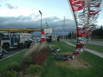 High winds cause damage at Milton auto dealership