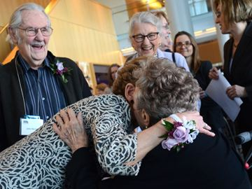 Premier Kathleen Wynne hugs Lois Hancey, while Pat Wynne and John Wynne look on, prior to the Women's Day tribute to Hancey at the Richmond Hill Centre for the Performing Arts Sunday. (Nick Iwanyshyn/York Region Media Group)