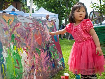 Three-year-old Chu Han Fu gets artistic during the fourth edition of Roncy Rocks! in Roncesvalles Village. (June 15, 2013)
