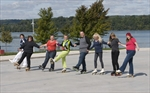 Skaters try out the surface at Hamilton's new winter outdoor rink as a roller skating surface.