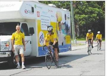 Team cycles from coast to coast for clean water; Cyclists' goal of $51– Image 1