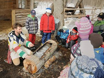 Grant Wilson, outdoor educator at The Tiffin Centre for Conservation, explains how first nations people made maple syrup by heating rocks and boiling the syrup in a hollowed out log.