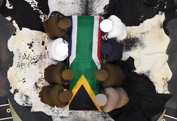 In this video frame frame, military officers prepare to lift South African President Nelson Mandela's casket following his funeral service in Qunu, South Africa, Sunday, Dec. 15, 2013.