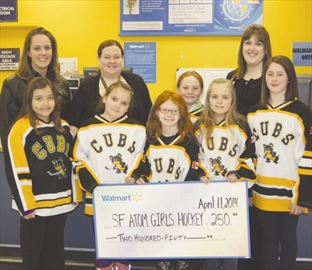 The Smiths Falls atom Cubs were the recipients of a $250 donation from Walmart on Thursday, April 10. The donation will help the girls tournament expenses. Pictured are (front) Haley Trudel, Lily Trudel, Samantha Salter, Mikayla Hodge, Mikyla Daoust