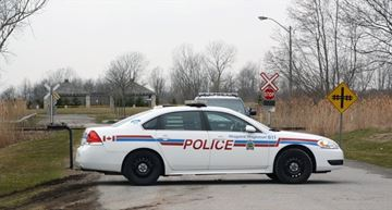 Niagara Regional Police cruisers block the entrance to the dog park in Port Colborne Friday morning after a body was discovered there Thursday. Police are releasing few details about the incident and said an investigation is ongoing. - Dave Johnson , The Welland Tribune