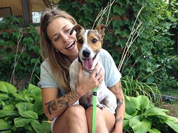 Alcona woman adopts stolen dog