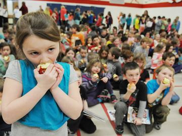 Some 450 students at Chemong Public School in Bridgenorth, including Jordyn Head, participate in the Great Big Crunch event on Thursday (March 6).Lance Anderson | This Week