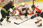 Midland Flyers goalies facing a ton of rubber