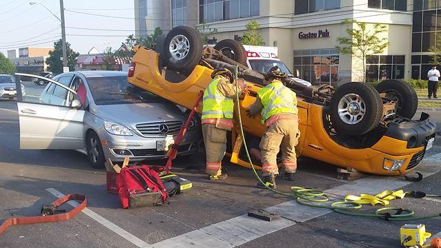 Truck rollover in Burlington sends several to hospital