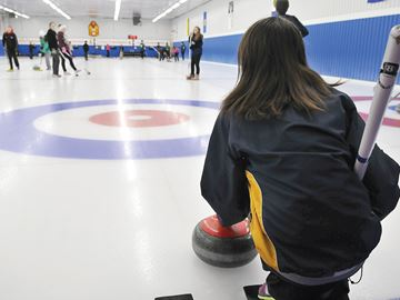 UXBRIDGE -- Natasha Brooks, of the Uxbridge Public School first team, prepared to curl a rock down the sheet at the Durham District School Board's student curling bonspiel. The Uxbridge team took on the Valley Farm Public School team, of Pickering. The Uxbridge first team finished the tournament with 27.5 points, Valley Farm with 16.25 points. The annual bonspiel was held at the Uxbridge Curling Club, hosted by Uxbridge Public School. March 4, 2014