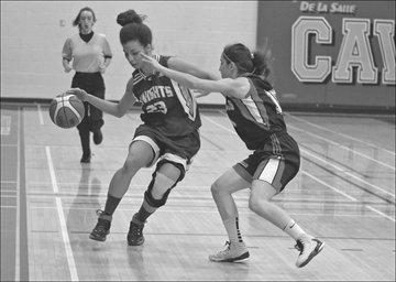St. Peter High School player Olivia Harris dribbles into the offensive zone as Louis Riel's Ashley Beaudoin-Polacek defends. Louis Riel won the city championship AAA-AAAA level game on Nov. 13. Louis Riel won the city championship on Nov. 13.