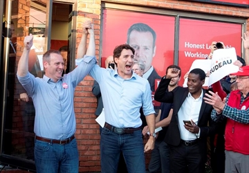 Prime Minister Justin Trudeau raises the arm of Carleton Liberal candidate Chris Rogers (left) attends as he attends and election campaign event in Manotick, Ontario, Monday September 9,2019. THE CANADIAN PRESS/Fred Chartrand