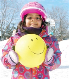 The Bayshore Community Association celebrated winter in style with shinny hockey, skating, and much more for the whole community on March 2 at Bayshore Park. Here, four-year-old Soman Falzai puts on a happy face during the festivities.