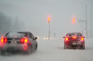 Cars make their way north on Leslie Street toward Hwy. 7 in Thornhill Feb. 8 during the height of a snow storm.